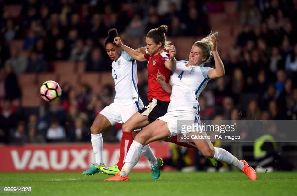 England's Millie Bright and Demi Stokes battle for the ball with Austria's Nina Burger during the International Friendly match at Stadium mk Milton...