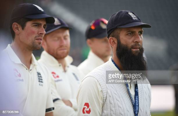 England's Moeen Ali and England's Alastair Cook series trophy after England won the fourth Test match against South Africa on day 4 of the fourth...