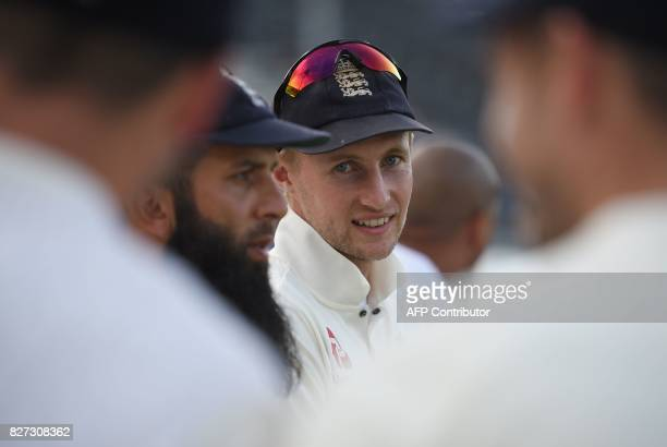 England's Moeen Ali and England's captain Joe Root wait to recieve the series trophy after England won the fourth Test match against South Africa on...