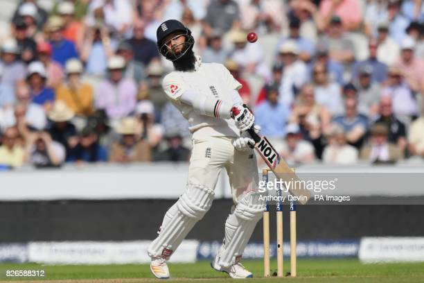 England's Moeen Ali avoids a bouncer from South Africa's Kagiso Rabada during day two of the Fourth Investec Test at Emirates Old Trafford Manchester