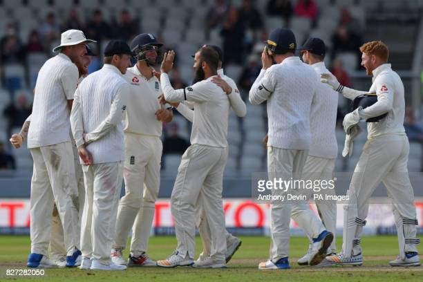 England's Moeen Ali Ben Stokes celebrates taking the wicket of South Africa's Theunis de Bruyn for 0 during day four of the Fourth Investec Test at...