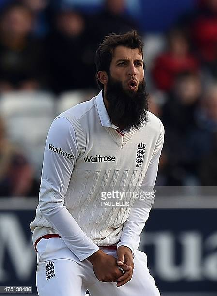 England's Moeen Ali bowls on the first day of the second cricket Test match between England and New Zealand at Headingley in Leeds northern England...