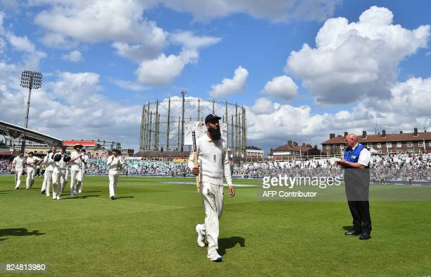 England's Moeen Ali carries a stumps as he leaves the pitch on the final day of the third Test match between England and South Africa at The Oval...