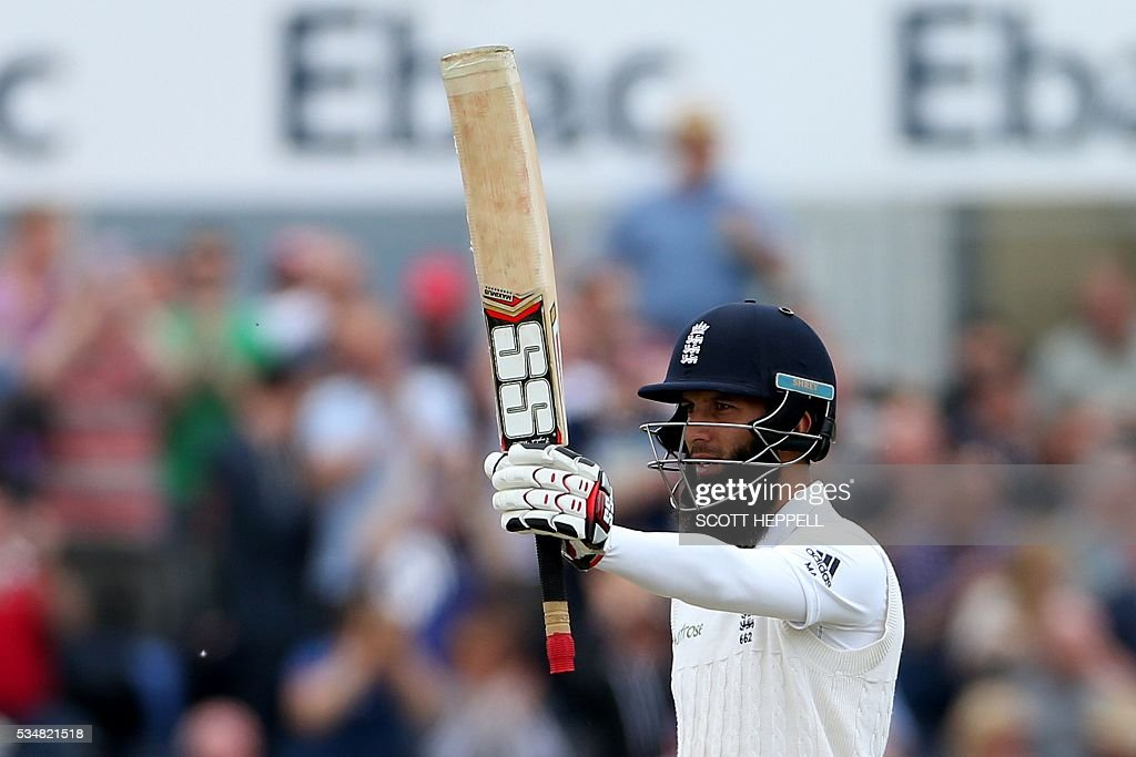 England's Moeen Ali celebrates after scoring 150 on the second day of the second test cricket match between England and Sri Lanka at the Riverside in Chester Le Street, north east England on May 28, 2016. / AFP / SCOTT