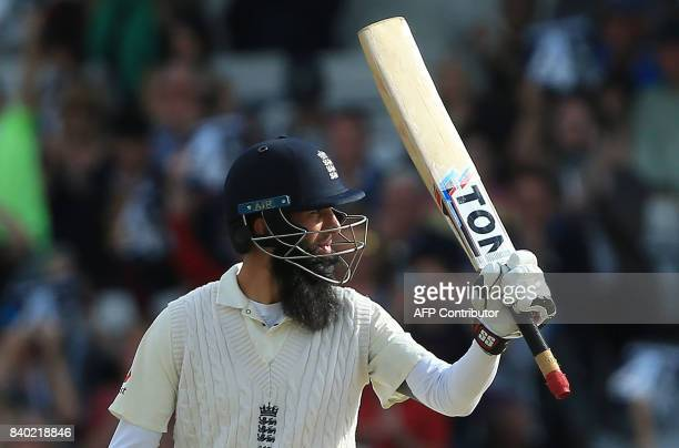 England's Moeen Ali celebrates his half century on the fourth day of the second international Test match between England and the West Indies at...