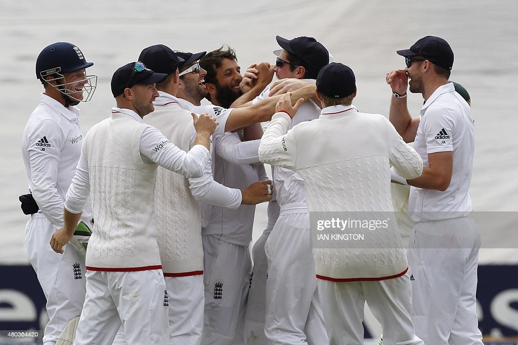Englands Moeen Ali celebrates taking the wicket of Australias Brad Haddin caught by Englands captain Alastair Cook during play on the fourth day of...