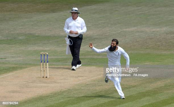 England's Moeen Ali celebrates taking the wicket of India's Mohammed Shami claiming his fifth wicket during day five of the Third Investec Test match...