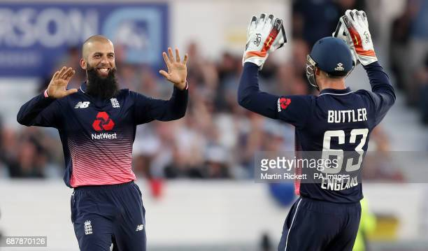 England's Moeen Ali celebrates taking the wicket of South Africa's Chris Morris with Jos Buttler during the One Day International at Headingley Leeds