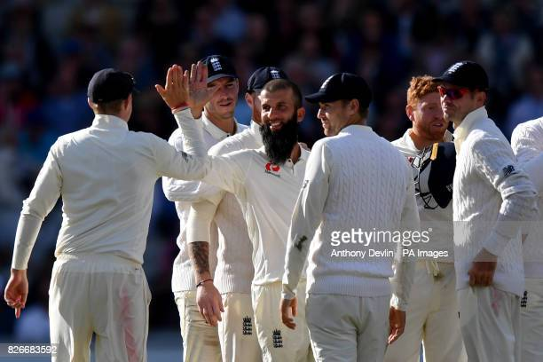 England's Moeen Ali celebrates taking the wicket of South Africa's Keshav Maharaj during day two of the Fourth Investec Test at Emirates Old Trafford...