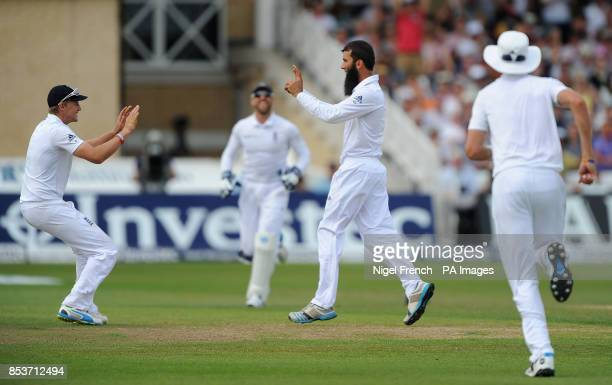 England's Moeen Ali celebrates with Joe Root after taking the wicket of India's Shikhar Dhawan during day four of the first Investec test match at...