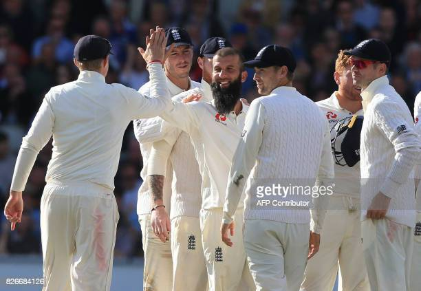 England's Moeen Ali celebrates with teammates the wicket of South Africa's Keshav Maharaj on the second day of the fourth Test match between England...