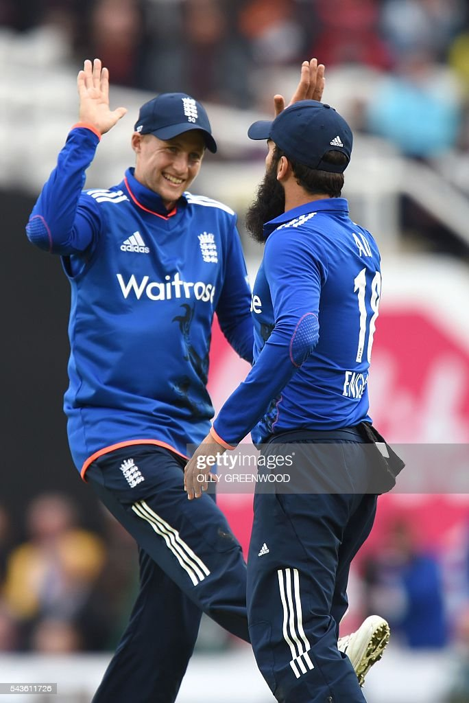 England's Moeen Ali (R) is congratulated by England's Joe Root (L) after taking a catch to dismiss Sri Lanka's Danushka Gunathilaka (not pictured) during play in the fourth One Day International (ODI) cricket match between England and Sri Lanka at The Oval cricket ground in London on June 29, 2016. England captain Eoin Morgan elected to field after winning the toss in the fourth one-day international against Sri Lanka at The Oval on Wednesday. ECB