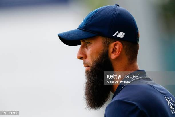 England's Moeen Ali is seen during the ICC Champions trophy cricket match between England and Bangladesh at The Oval in London on June 1 2017 / AFP...