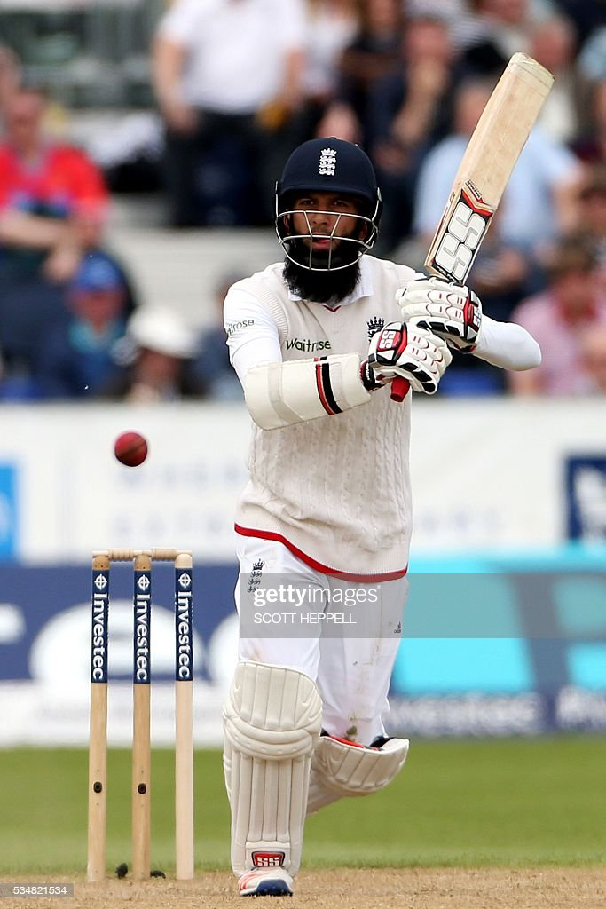 England's Moeen Ali plays a shot on the second day of the second test cricket match between England and Sri Lanka at the Riverside in Chester Le Street, north east England on May 28, 2016. / AFP / SCOTT