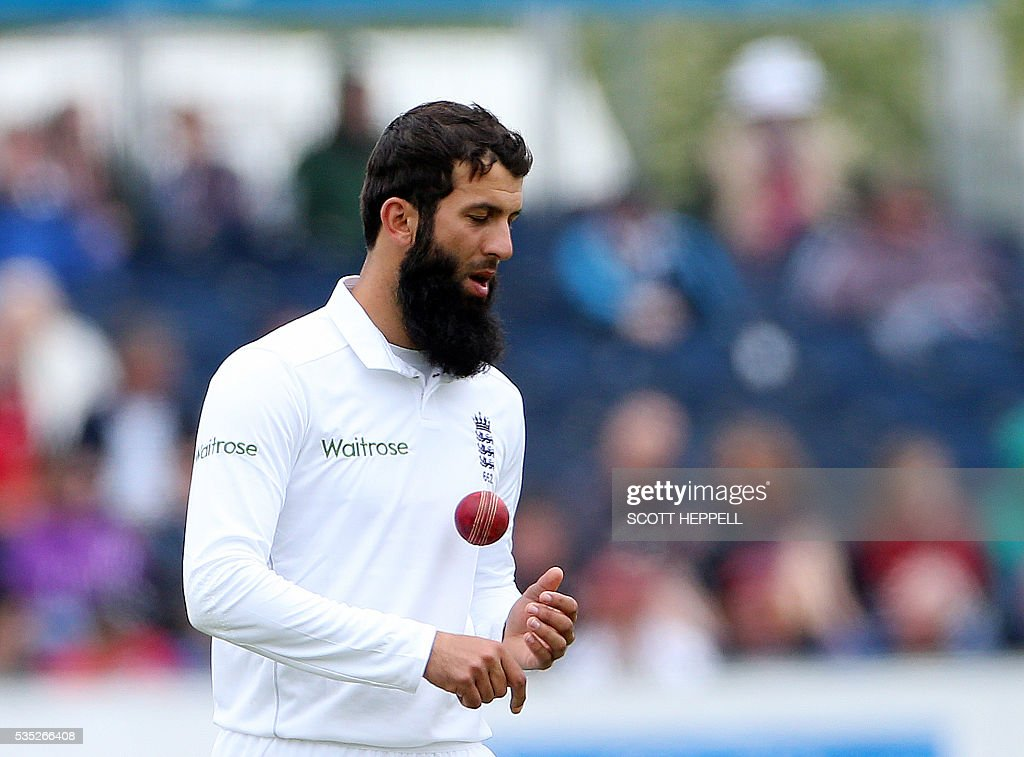 England's Moeen Ali prepares to bowl on the third day of the second test cricket match between England and Sri Lanka at the Riverside in Chester Le Street, north east England on May 29, 2016. / AFP / SCOTT