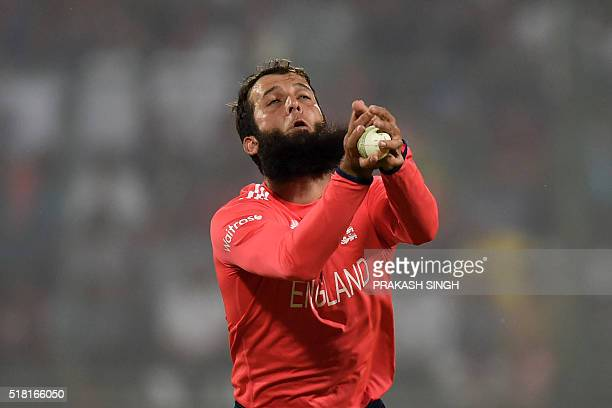 England's Moeen Ali takes a catch to dismiss New Zealand's captain Kane Williamson during the World T20 cricket tournament semifinal match between...
