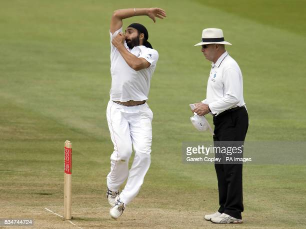 England's Monty panesar bowls as umpire Daryl Harper looks on during The First npower Test match at Lord's Cricket Ground London