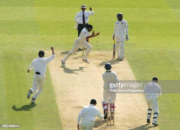 England's Monty Panesar celebrates after having Sri Lanka batsman Upul Tharanga caught by wicketkeeper Geraint Jones for 52 runs during the 1st Test...