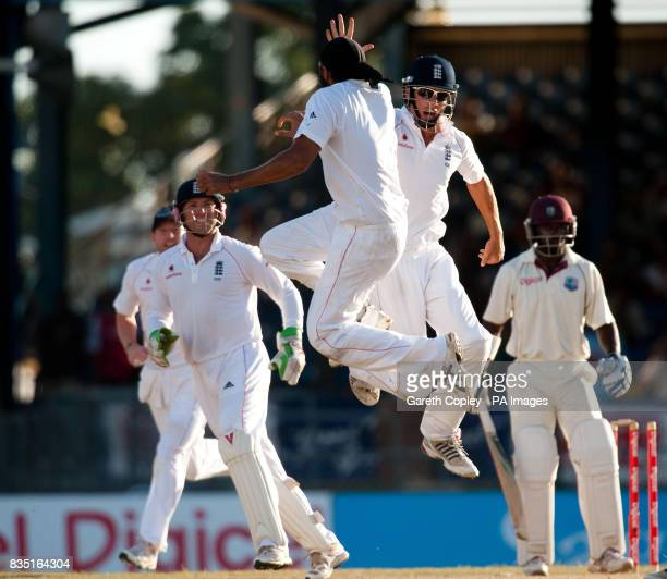 England's Monty Panesar celebrates with Alastair Cook after bowling West Indies' Devon Smith during the fifth test at Queen's Park Oval Port of Spain...