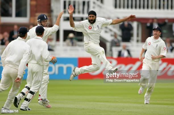 England's Monty Panesar celebrates with Alastair Cook after having Sri Lanka batsman Kumar Sangakkara caught by wicketkeeper Geraint Jones for 65...