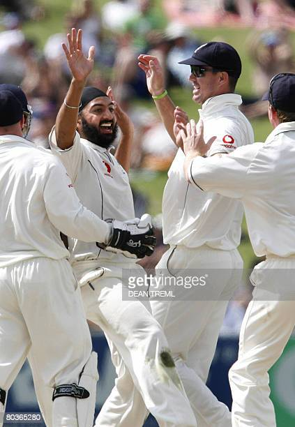 England's Monty Panesar celebrates with team mates Tim Ambrose Kevin Pietersen and Paul Collingwood after taking the wicket of New Zealand's Jamie...