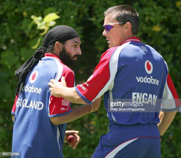 England's Monty Panesar gets a pat on the back from Ashley Giles during a training session before the 3rd Test match between Australia and England at...