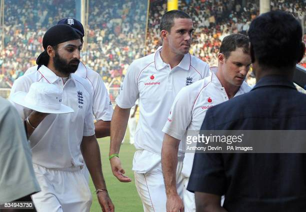 England's Monty Panesar Kevin Pietersen and Andrew Strauss leave the field during the fifth day of the First Test Match at the M A Chidambaram...