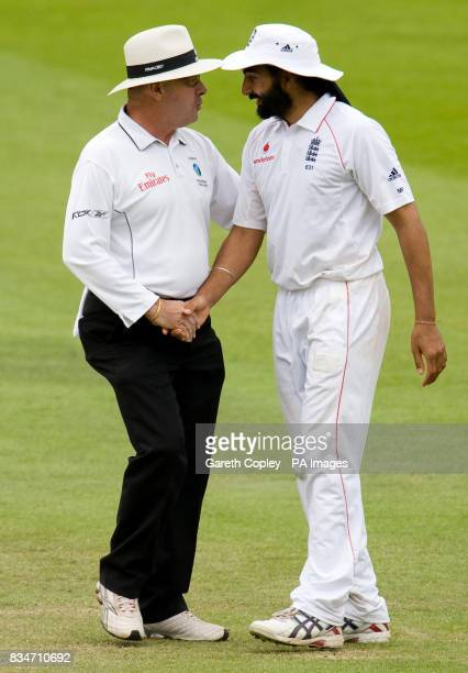 England's Monty Panesar talks to umpire Daryl Harper during The First npower Test match at Lord's Cricket Ground London