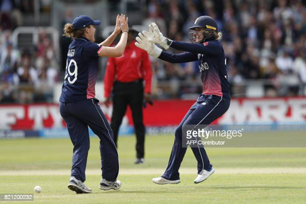 England's Natalie Sciver and Sarah Taylor celebrate the wicket of India's Mithali Raj during the ICC Women's World Cup cricket final between England...