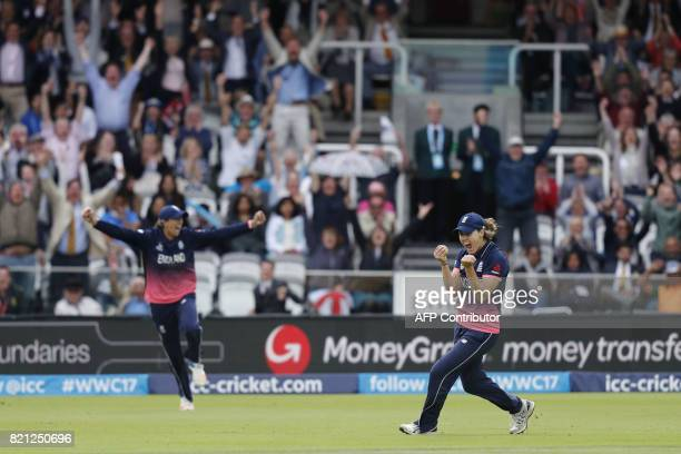 England's Natalie Sciver celebrates after catching India's Deepti Sharma during the ICC Women's World Cup cricket final between England and India at...