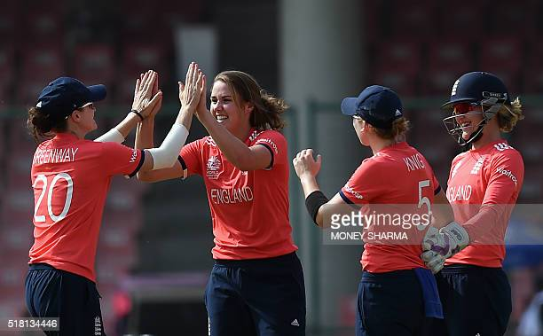 England's Natalie Sciver celebrates with teammates after dimissing Australia's Ellyse Perry during the World T20 women cricket tournament semifinal...