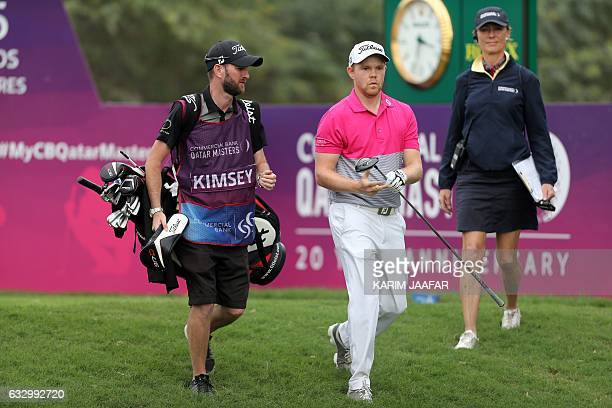 England's Nathan Kimsey competes during the Qatar Masters golf tournament at the Doha Golf Club in Doha on January 29 2017 / AFP / KARIM JAAFAR