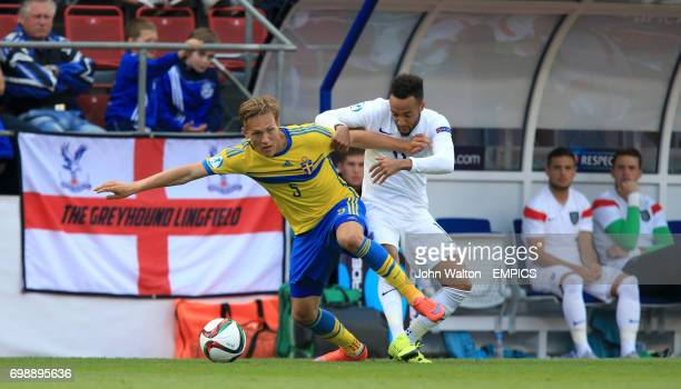 England's Nathan Redmond and Sweden's Ludwig Augustinsson battle for the ball