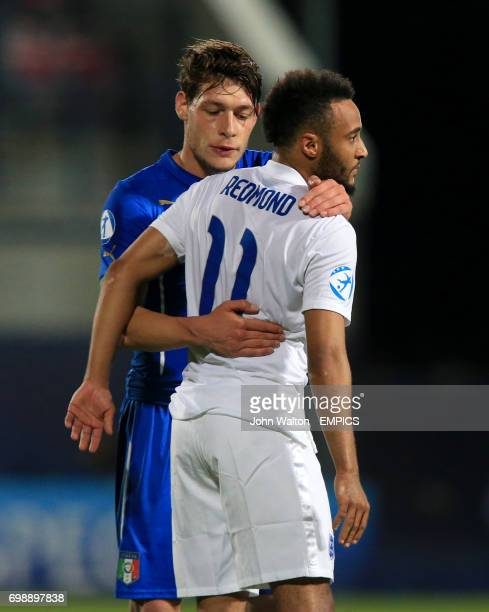 England's Nathan Redmond shakes hands with Italy's Andrea Belotti after the match