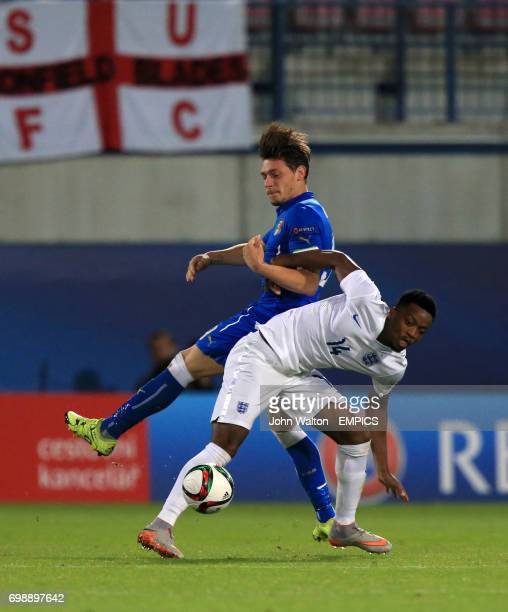 England's Nathaniel Chalobah and Italy's Andrea Belotti battle for the ball