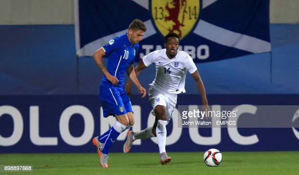 England's Nathaniel Chalobah and Italy's Domenico Berardi battle for the ball