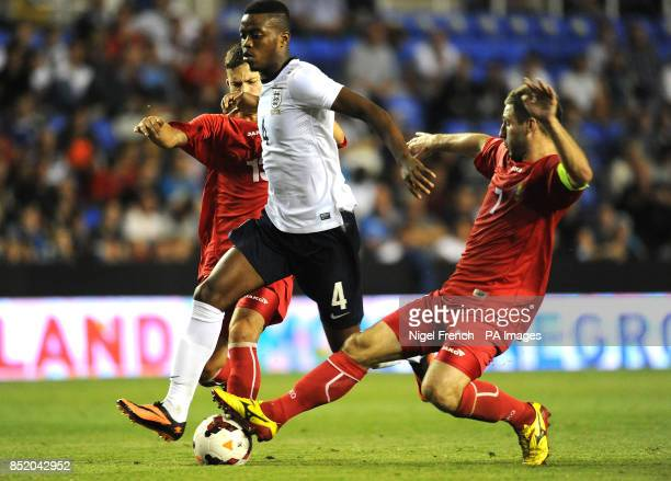 England's Nathaniel Chalobah battle for the ball against Moldova's Igor Dima and Eugen Zasaviitchi during the UEFA Euro Under 21's Qualifying match...