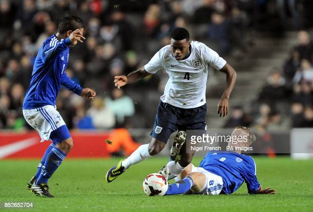 England's Nathaniel Chalobah in action with Finland's Kalle Kauppi and Moshtagh Yaghoubi