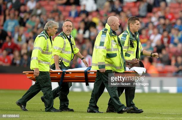 England's Nathaniel Chalobah is stretchered off the pitch after picking up an injury