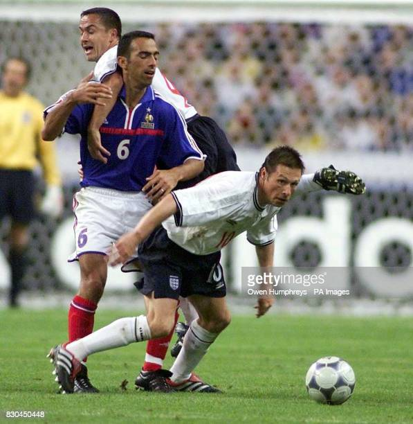 LEAGUE England's Nick Barmby and Dennis Wise in action against France's Youri Djorkaeff during their friendly international football match at the...