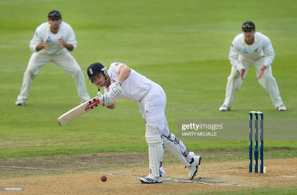 England's Nick Compton bats with New Zealand fielders Dean Brownlie (R) and Hamish Rutherford (L) during day four of the first international cricket Test match between New Zealand and England played at the University Oval park in Dunedin on March 9, 2013. AFP PHOTO / Marty MELVILLE