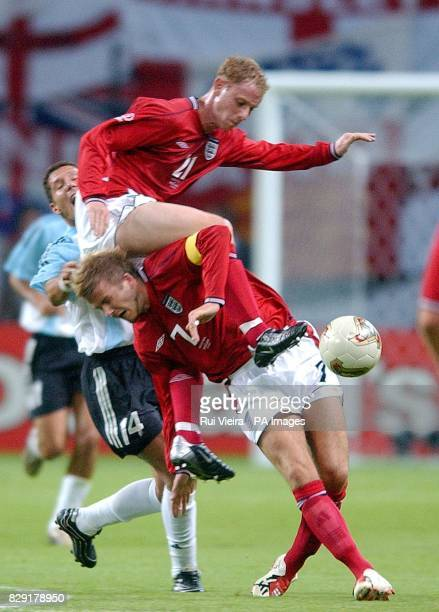 England's Nicky Butt and David Beckham collide as they challenges Diego Simeone of Argentina for the ball during their second Group F match in the...