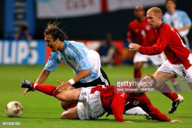 England's Nicky Butt slides in on Argentina's Gabriel Batistuta