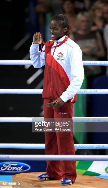England's Nicola Adams holds her Gold Medal after victory in the Women's Fly Final Bout at the SSE Hydro during the 2014 Commonwealth Games in Glasgow