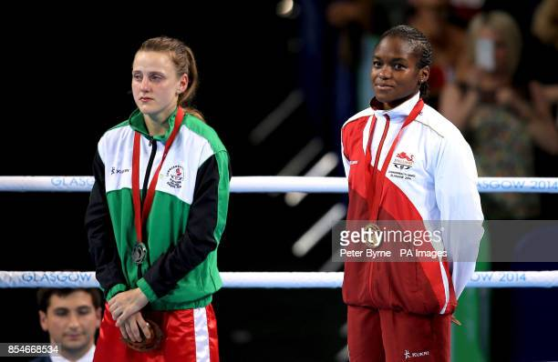 England's Nicola Adams holds on the podium after her victory over Northern Ireland's Michaela Walsh in the Women's Fly Final Bout at the SSE Hydro...