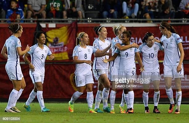 England's Nikita Parris celebrates with teammates after scoring the opening goal during a Euro 2017 qualifying women's football match between Belgium...