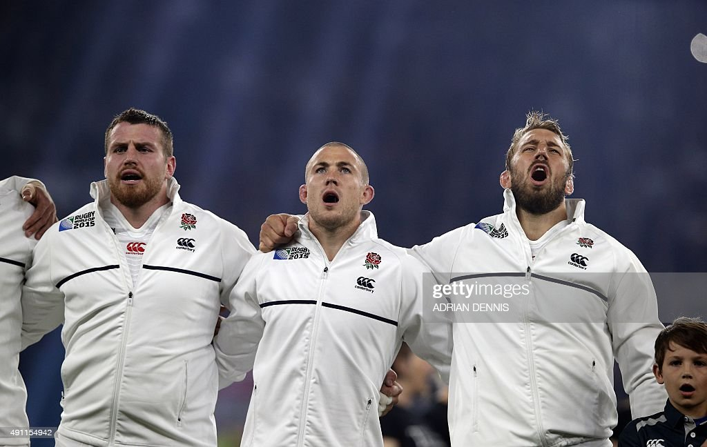 England's number 8 Ben Morgan England's fullback Mike Brown and England's flanker and captain Chris Robshaw sing the national anthem prior to a Pool...