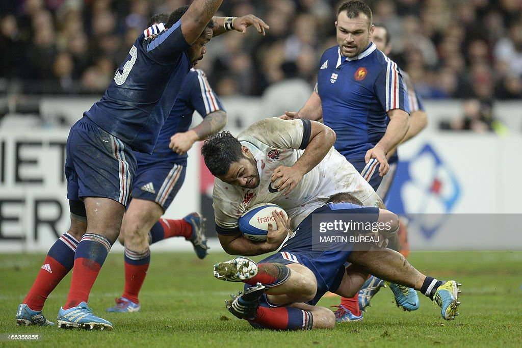 England's number 8 Billy Vunipola (C) is tackled during the Six Nations rugby union match between France and England on February 1, 2014 at the Stade de France in Saint-Denis, north of Paris. AFP PHOTO / MARTIN BUREAU