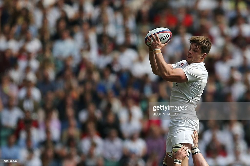 England's number 8 Jack Clifford catches the ball from a line out during the international rugby union match between England and Wales at Twickenham Stadium in west London on May 29, 2016. / AFP / JUSTIN