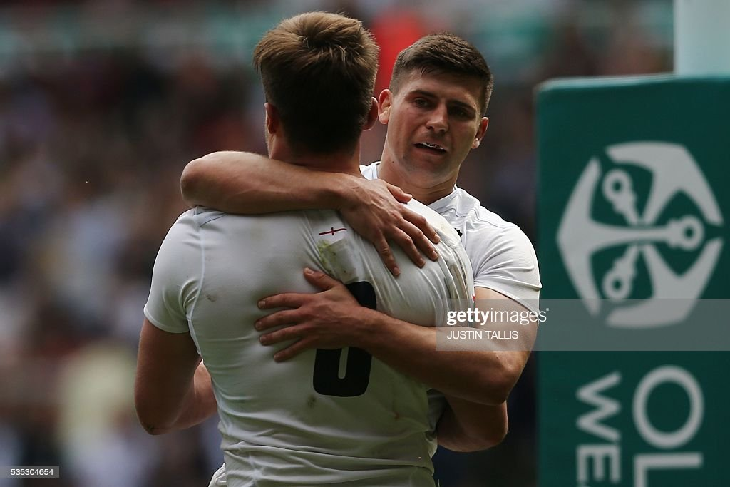 England's number 8 Jack Clifford (L) celerbates with England's scrum half Ben Youngs (R) after scoring a try during the international rugby union match between England and Wales at Twickenham Stadium in west London on May 29, 2016. / AFP / JUSTIN